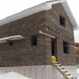 Двухэтажный дом из арболита с встроенной баней